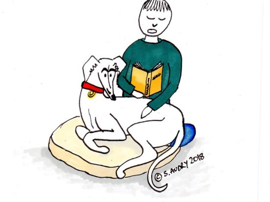 Owner reading to their dog