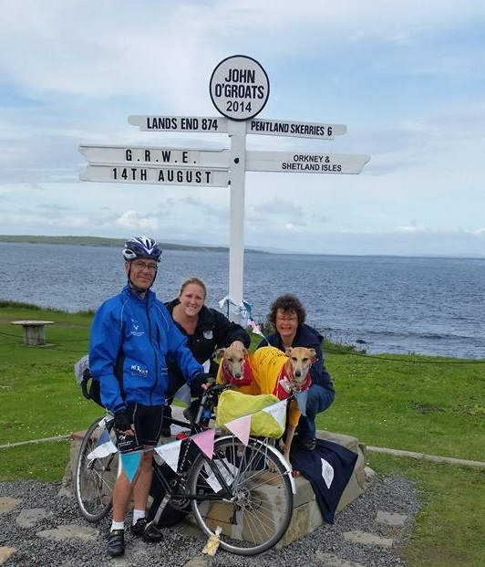Toby standing by John O'Groats sign