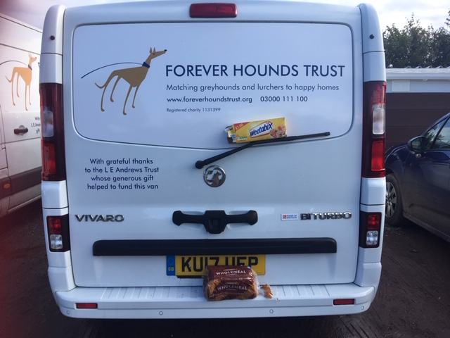 Forever Hounds Trust van with a box of weetabix and loaf of bread
