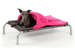 Dog bed with pink cover