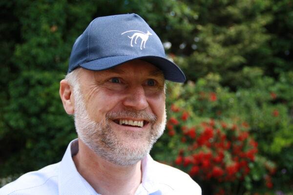 Man wearing blue baseball cap